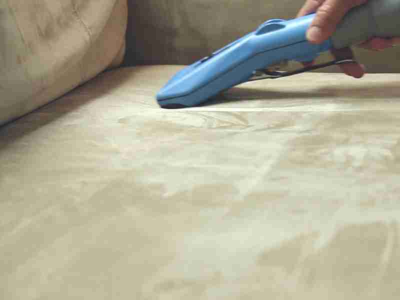 cleaning upholstered sofa before storage